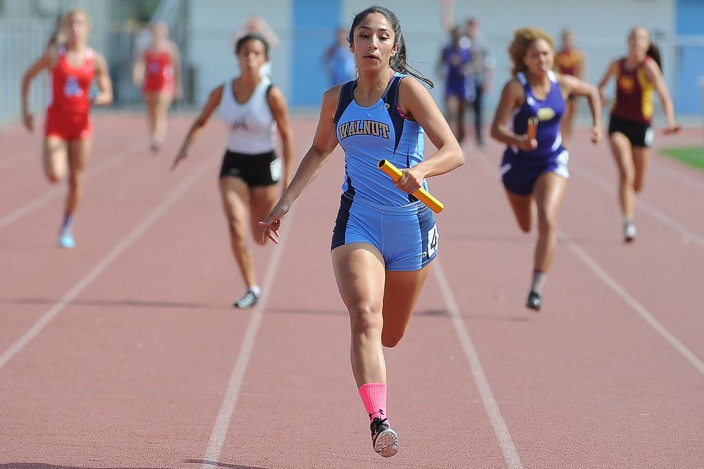 Description of . Walnut wins as Victoria Sanoval runs the last leg of the 4x100 relay during the Hacienda League track finals in Walnut, Calif., on Thursday, May 8, 2014.  (Keith Birmingham Pasadena Star-News)