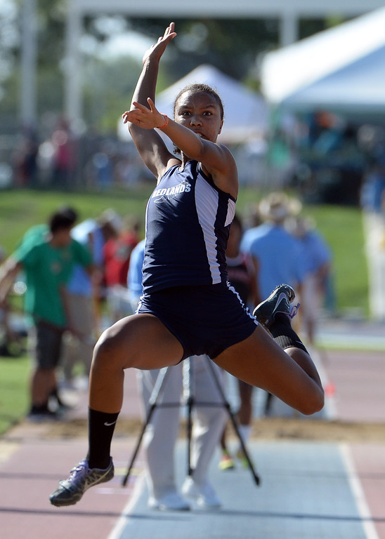 Description of . Redlands Margaux Jones wins the long jump during the CIF California State Track & Field Championships at Veteran's Memorial Stadium on the campus of Buchanan High School in Clovis, Calif., on Saturday, June 7, 2014. 