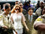 Actress Lindsay Lohan is showered with gold glitter, second left, as she walks with her attorney Mark Heller, for her trial Monday, March 18, 2013, at  Los Angeles Superior court. Lohan is charged with three misdemeanor counts stemming from a crash on Pacific Coast Highway. She is charged with willfully resisting, obstructing or delaying an officer, providing false information to an officer and reckless driving. She is also accused of violating her probation in a misdemeanor jewelry theft case. (AP Photo/Damian Dovarganes)