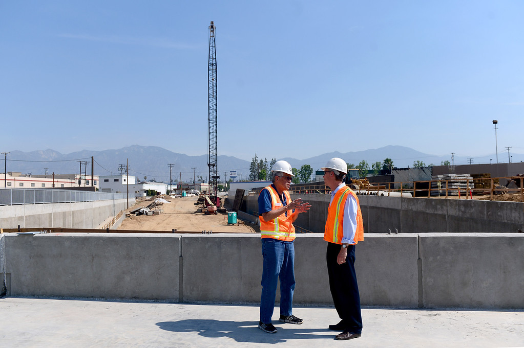 Description of . Mark Christoffels, right, CEO and chief engineer of ACE, speaks with an official on the newly built railroad bridge on the northern half of the grade separation at Baldwin Avenue and Gidley Street in El Monte Friday, May 16, 2014. The 2-year project, which closed Baldwin Avenue, is one of 22 underpasses from Los Angeles to Pomona that are done or expected to be completed by 2019. Baldwin Avenue is halfway complete. (Photo by Sarah Reingewirtz/Pasadena Star-News)