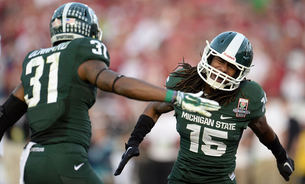 Description of . Michigan State cornerback Trae Waynes (15) reacts after tackling Stanford running back Tyler Gaffney )not pictured) for a loss of yards in the second half of the 100th Rose bowl game in Pasadena, Calif., on Wednesday, Jan.1, 2014. Michigan State won 24-20.