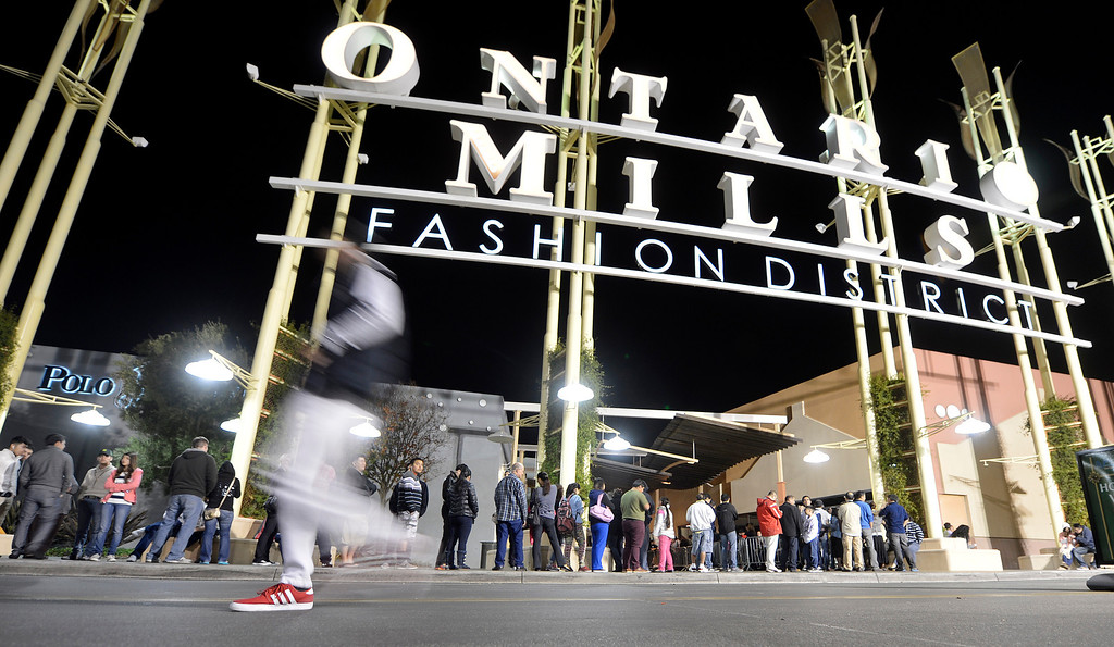Description of . Thousands of holiday shoppers descend on the Ontario Mills Thursday night November 28, 2013 for the malls 8p.m. opening. (Will Lester/Inland Valley Daily Bulletin)