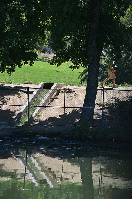 Description of . The Redlands Fire Department is assisting the Rotary Clubs Tuesday July 9, 2014 in a project intended to revitalize the lower pond at Ford Park. The fire department is making use of the project to conduct training as well. The training called