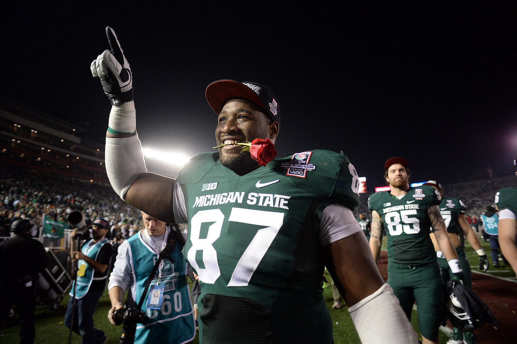 Description of . Michigan State's Brandon Clemons #87 walks in the locker room after winning  the 100th Rose Bowl game in Pasadena Wednesday, January 1, 2014. Michigan State defeated Stanford 24-20. (Photo by Hans Gutknecht/Los Angeles Daily News)