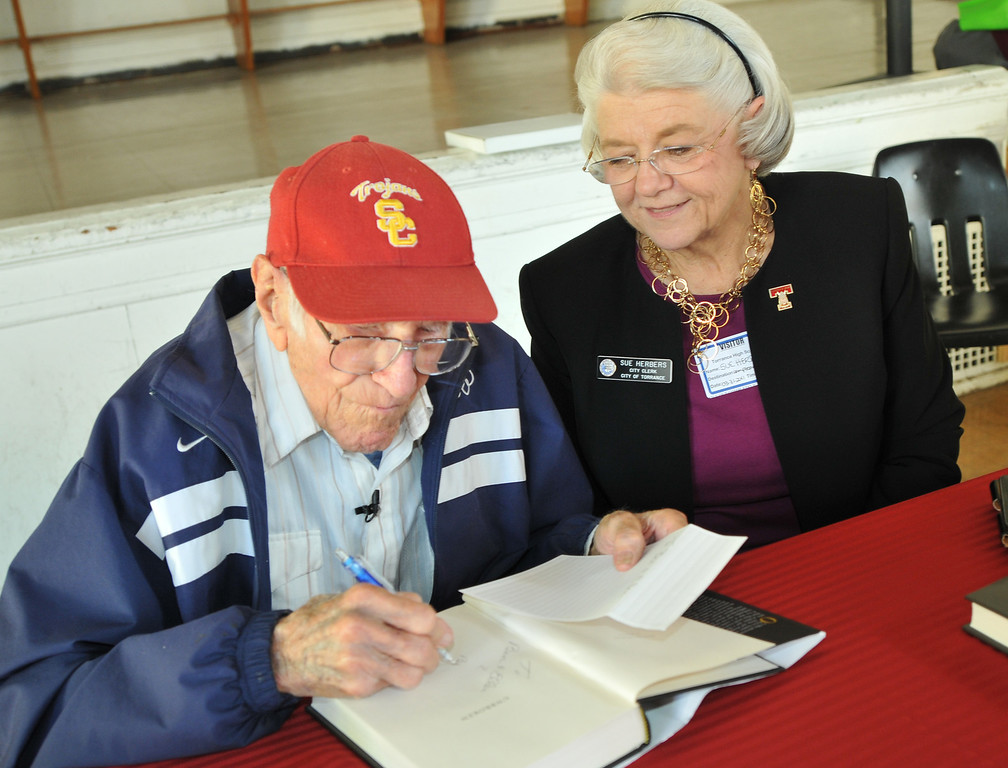 Description of . Torrance---3/31/11---Daily Breeze Photo:  Robert Casillas ---  Torrance legend Louis Zamperini paid a visit to his alma mater Torrance High to visit with alumni and meet students.