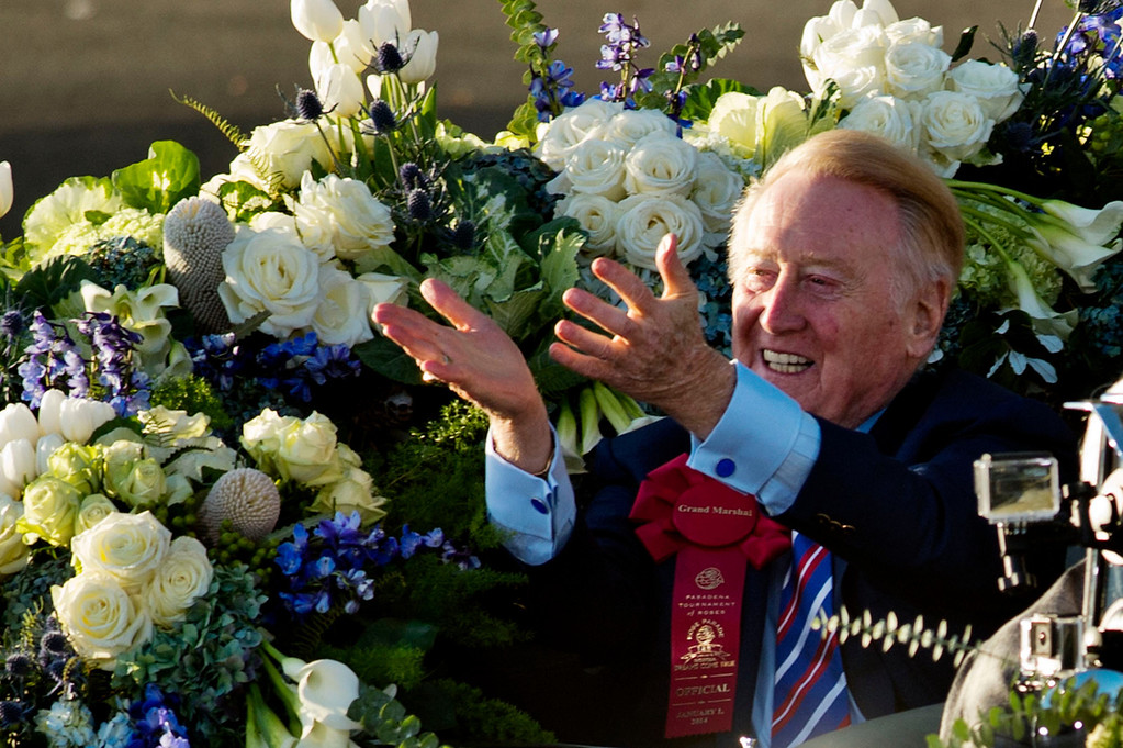 Description of . Parade Grand Marshall and voice of the Los Angeles Dodgers Vin Scully rides in a 1950 Oldsmobile 98 Coupe Convertible during 2014 Rose Parade in Pasadena, Calif. on January 1, 2014. (Staff photo by Leo Jarzomb/ Pasadena Star-News)