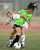 Quartz Hill #7 Kristen Osuna and South Torrance #14 Anju Takei get tangled up. The Girls from Quartz Hill defeated South Torrance in a sudden death overtime in a Southern Section Division IV Semifinal soccer game. Quartz Hills, CA 2/23/2013(John McCoy/Staff Photographer)