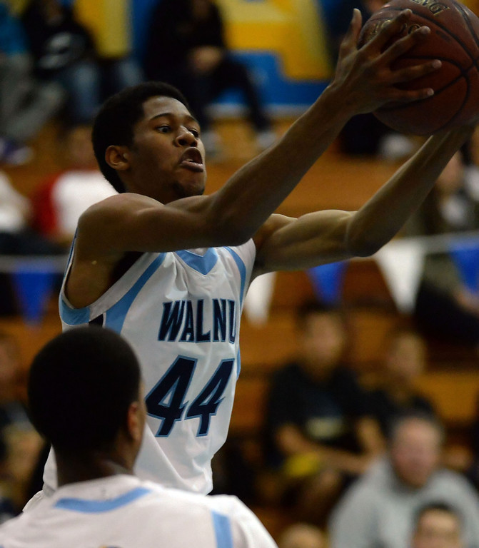 Description of . Walnut's Richard Rycraw (C) (44) rebounds against Los Altos in the first half of a prep basketball game at Walnut High School in Walnut, Calif., on Wednesday, Jan. 22, 2014. (Keith Birmingham Pasadena Star-News)