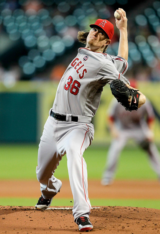 Description of . HOUSTON, TX - SEPTEMBER 14:  Jered Weaver #36 of the Los Angeles Angels of Anaheim throws in the first inning against the Houston Astros at Minute Maid Park on September 14, 2013 in Houston, Texas.  (Photo by Bob Levey/Getty Images)