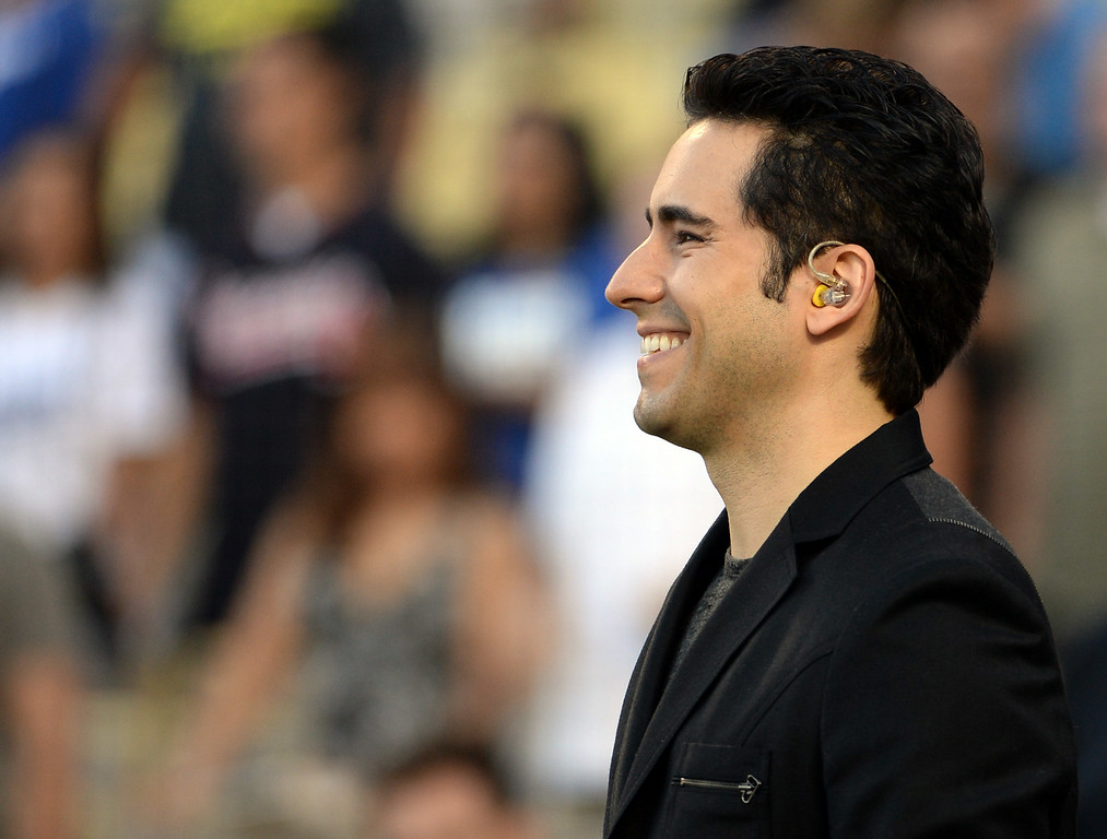 Description of . Jersey Boys cast member John Lloyd Young prepares to sing the National Anthem prior to a Major league baseball game between the San Diego Padres and the Los Angeles Dodgers on Saturday, July 12, 2014 in Los Angeles.   (Keith Birmingham/Pasadena Star-News)