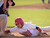 Whittier High's Tommy Estrella dives back safe at first base in the second inning vs Calvary Chapel High (Santa Ana) at St. Paul High's campus field as part of the 30th annual Newport Elks Tournament March 4, 2013.  (SGVN/Staff photo by Leo Jarzomb)