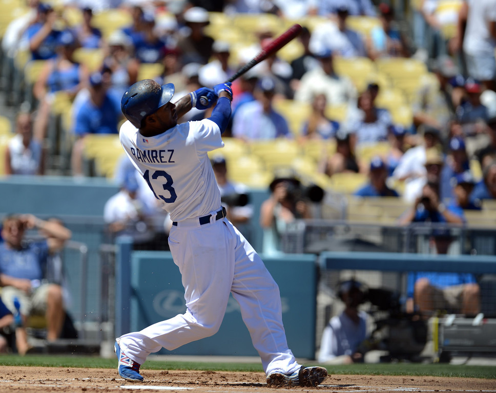 Description of . The Dodgers' Hanley Ramirez #13 slugs a solo homer in the 1st inning during their game agains the Cubs at Dodger Stadium Wednesday, August 28, 2013. The Dodgers beat the Cubs 4-0. (Hans Gutknecht/Los Angeles Daily News)