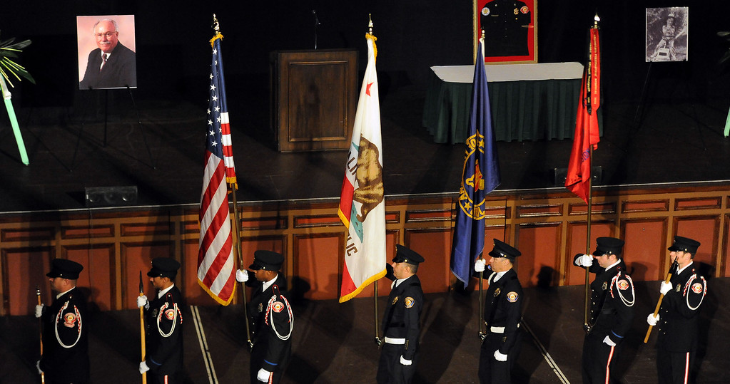 Description of . The color guard marches during a celebration of life service for former Pasadena Fire dept. Capt. and California State fire marshall, John Tennant at the Pasadena Civic Auditorium in Pasadena, Calif., on Wednesday, Feb. 5, 2014. (Keith Birmingham Pasadena Star-News)