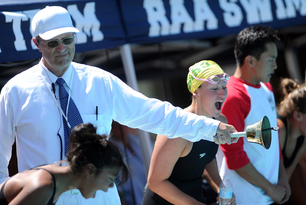 Description of . Official Bill Sullivan rings the bell for the last lap during the 500 freestyle race during the CIF-SS Division II swim finals at Riverside City College on Saturday, May 11, 2013 in Riverside, Calif.  (Keith Birmingham Pasadena Star-News)