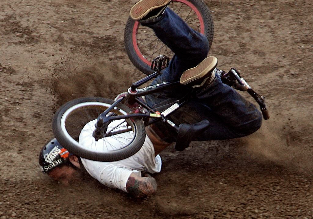 Description of . Cory Nastazio of Riverside,Calif., crashes hard on his face during the first round of the BMX Freestyle Dirt Finals during the Eleventh X Games at the Home Depot Center in Carson ,Calif., August 6. 2005. (Pasadena Star-News Staff Photo Keith Birmingham/SXSports)
