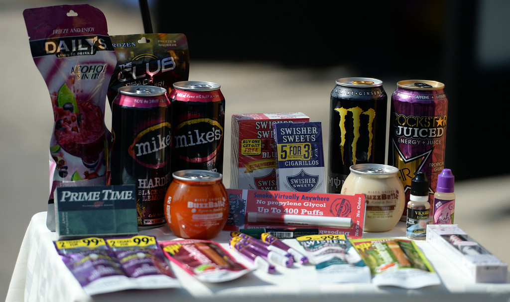 Description of . A display of tobacco and high sugar foods during a press conference announcing new data on the availability and marketing of tobacco, alcohol and food products in stores at Euclid Market in Los Angeles on Wednesday, March 5, 2014.  (Keith Birmingham Pasadena Star-News)