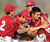 Covina relief pitcher Joseph Wills, right, is mobbed by teammates after striking out Northview's Adrian Sabatino (not pictured) for the final out of the game as Covina defeated Northview 4-3 during a prep baseball game at Northview High School on Tuesday, March 19, 2013 in Covina, Calif.  
