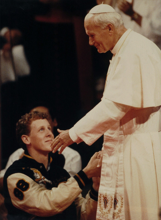 Description of . Pope John Paul II greets Stephen Donley during a teleconference at the Universal Amphitheatre in 1987. (Los Angeles Daily News file photo)