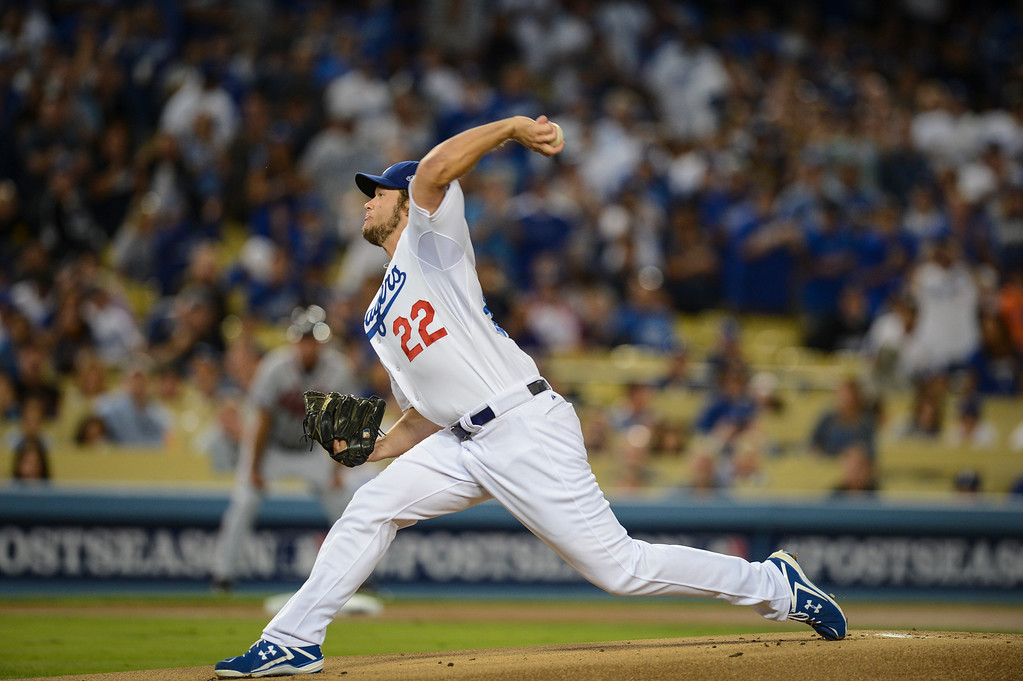 Description of . Dodgers' Clayton Kershaw pitches after a short rest in game 4 against Atlanta  Monday, October 7, 2013 ( Photo by Hans Gutknecht/Los Angeles Daily News )