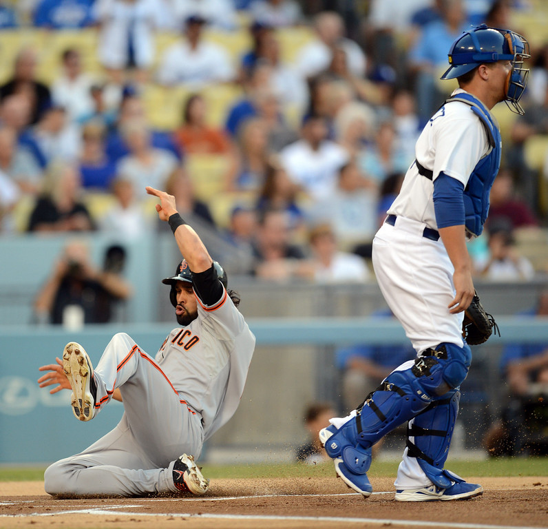 Description of . The Giants' Angel Pagan #16 scores in the first inning as Dodger catcher Tim Federowicz #18 waits for the throw during their game at Dodgers Stadium Saturday, September 14, 2013. (Photo by Hans Gutknecht/Los Angeles Daily News)