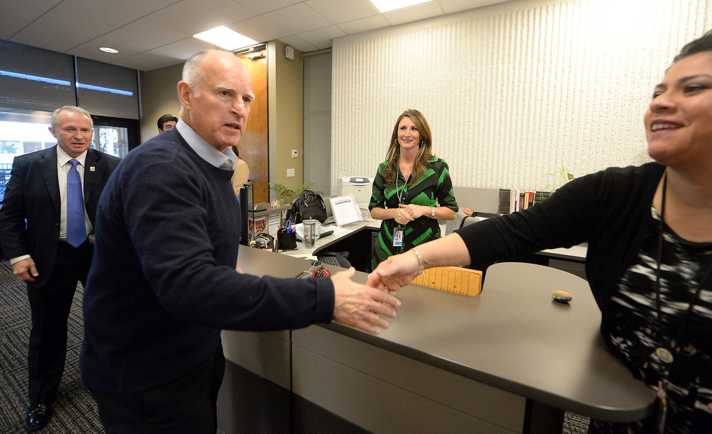 Description of . California Governor Jerry Brown greets employess at the Riverside County Office of Education Tuesday January 14, 2014. (Will Lester/Inland Valley Daily Bulletin)