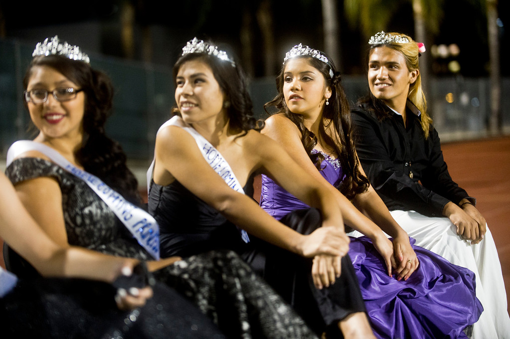 Description of . Patrick Cordova, 16, right, a transgender senior who is running for Azusa High 2013 Homecoming Queen sits with the homecoming court during the homecoming game at Citrus College Stadium in Glendora on Friday night, Sept. 27, 2013.( Photo by Watchara Phomicinda/ San Gabriel Valley Tribune)