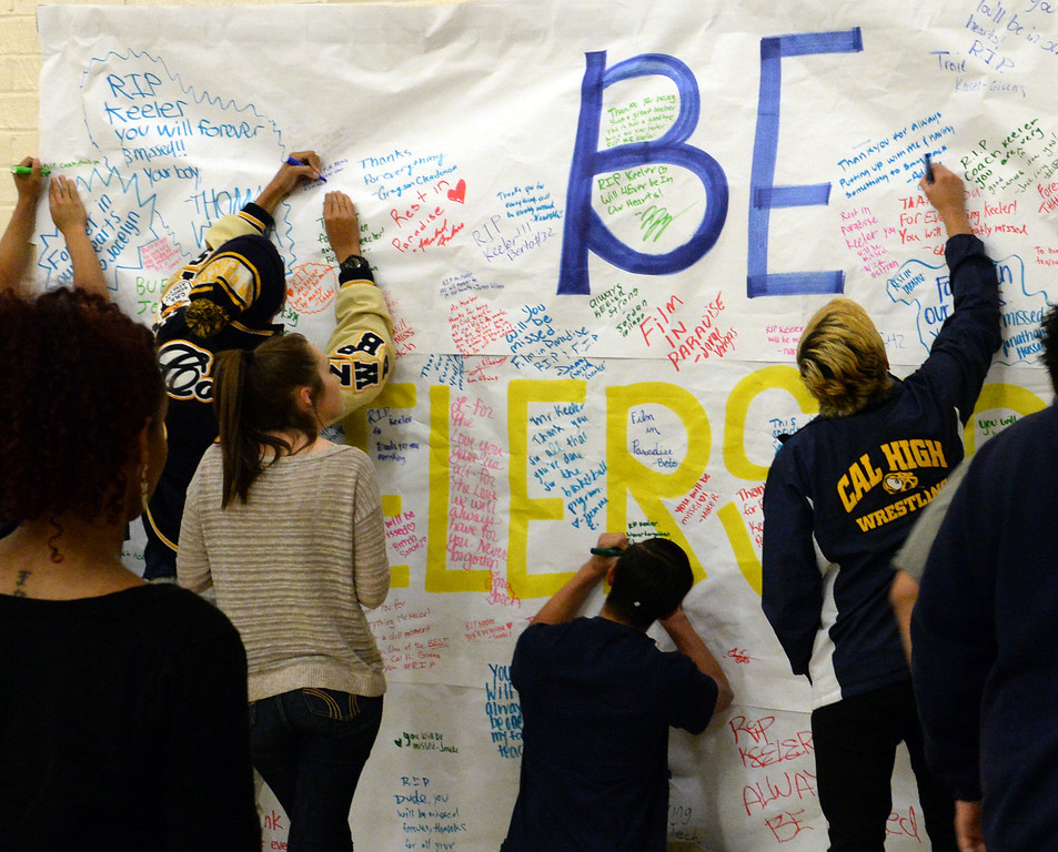 Description of . Students sign a 'Be Keeler Strong