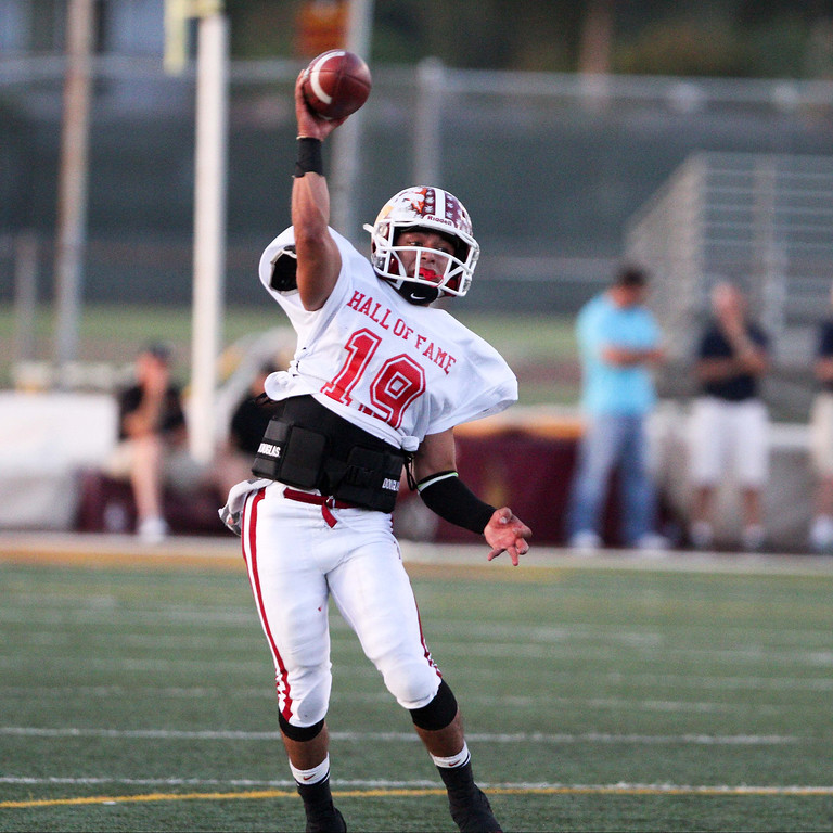 Description of . La Serna's Frankie Palmer (19) attempts a pass during the 35th Annual Hall of Fame All-Star Football Game at West Covina High School in West Covina, CA on Friday, May 16, 2014. (Correspondent Photo by David Thomas for the Pasadena Star News)