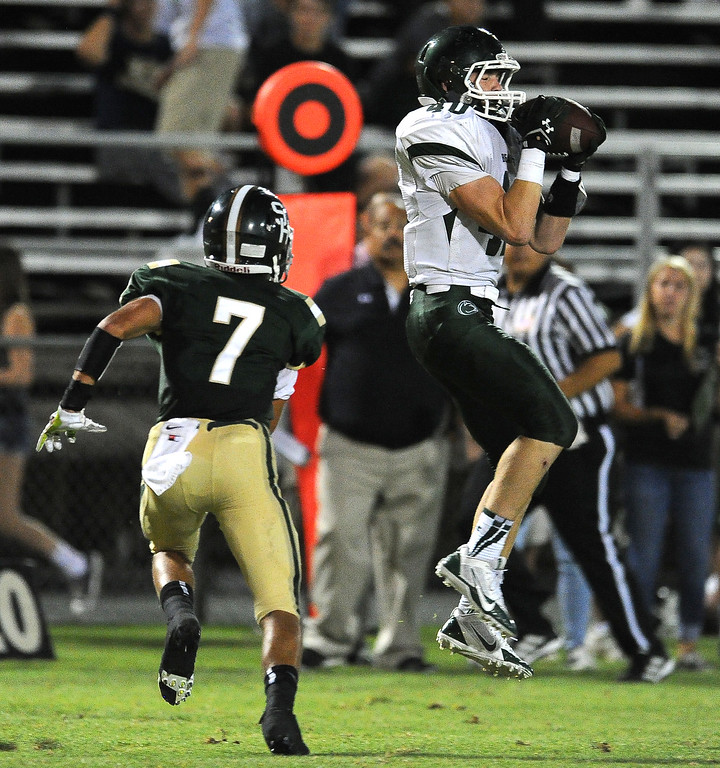 Description of . Bonita's Richie Cochran (40) catches a pass for a first down over South Hills' Quinn Cotter (7) in the first half of a prep football game at Covina District Field in Covina, Calif. on Friday, Sept. 6, 2013.   (Photo by Keith Birmingham/Pasadena Star-News)