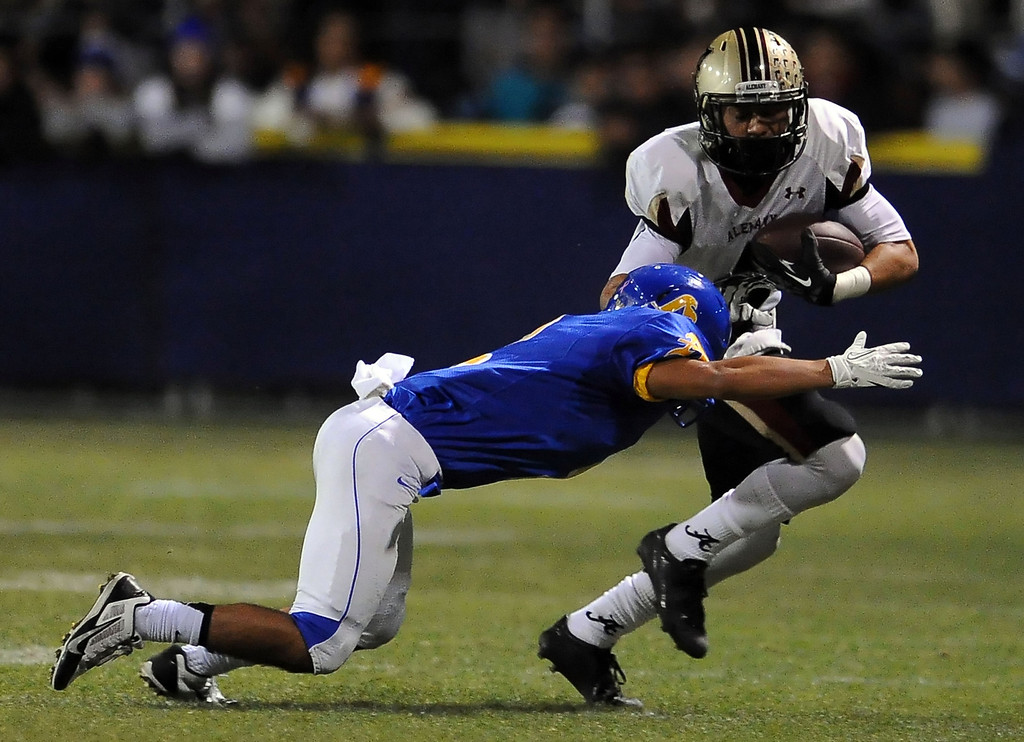 Description of . Alemany's Brandon Pierce (4) in the first half of a prep football game against Bishop Amat at Bishop Amat High School in La Puente, Calif., on Friday, Oct. 25, 2013.    (Keith Birmingham Pasadena Star-News)