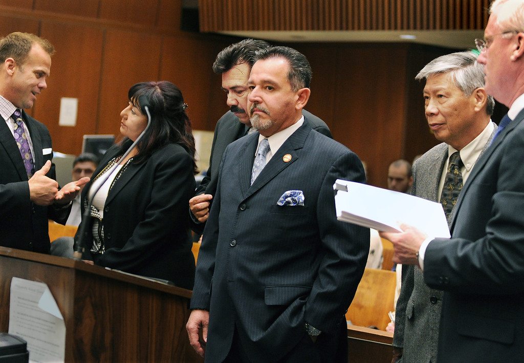 Description of . Former Irwindale Councilwoman Rosemary Ramirez, left,  Councilman, Manuel Garcia,  Mayor Mark Breceda, and Finance Director Abe DeDios with their attorneys at Clara Shortridge Foltz Criminal Justice Center Thursday, February 27, 2014.  Irwindale officials are accused of misappropriation of public funds, conflict of interest and embezzlement spending $200,000 on trips to New York City between 2001-2005.  Their arraignment was postponed once again to April 9, 2014.(Photo by Walt Mancini/San Gabriel Valley Tribune)