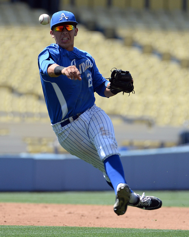 Description of . Bishop Amat shortstop Adryan Ramirez throws out Palm Desert's Gil Sauceda in the third inning of the CIF-SS Division 3 baseball championship at Dodger Stadium in Los Angeles on Friday, June 6, 2014. Bishop Amat won 4-3.   (Keith Birmingham/Pasadena Star-News)