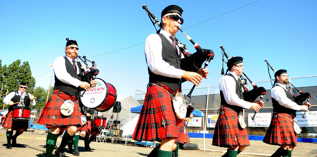 Description of . Nicholson Pipes and Drums of Westminster perform during the 4th annual La Habra Highlanders car show at La Habra High School in La Habra Calif. on Saturday, Sept. 7, 2013.   (Photo by Keith Birmingham/Pasadena Star-News)