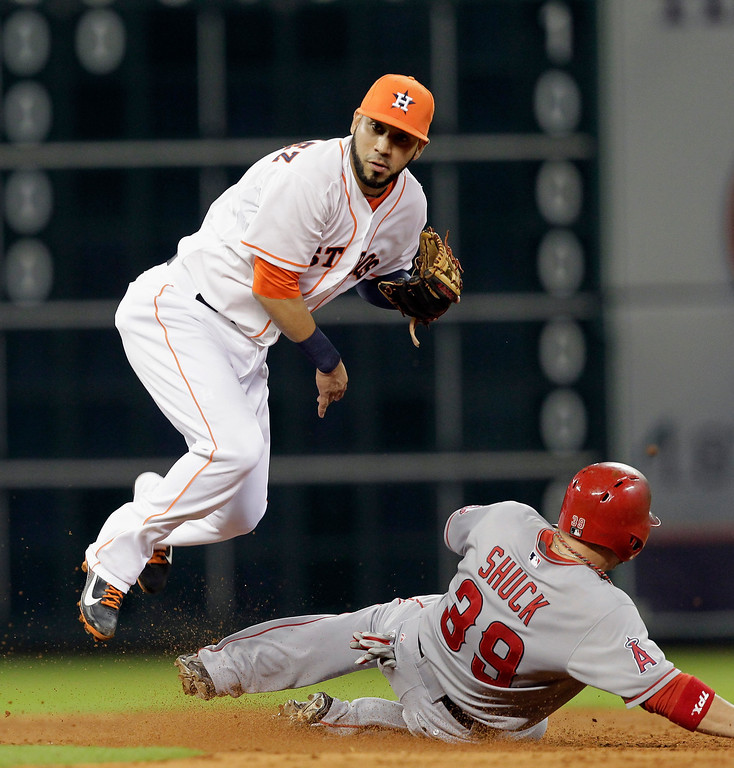 Description of . HOUSTON, TX - SEPTEMBER 14:  Marwin Gonzalez #9 of the Houston Astros turns a double play as J.B. Shuck #39 of the Los Angeles Angels of Anaheim slides into second base at Minute Maid Park on September 14, 2013 in Houston, Texas.  (Photo by Bob Levey/Getty Images)