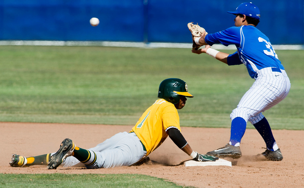 Description of . Mira Costa's Keyon Allen (#1) slides back to second base in the sixth inning during quarterfinal baseball, Mira Costa at Bishop Amat on Friday, May 24, 2013. Mira Costa won 4-2. (SGVN/Staff photo by Watchara Phomicinda)