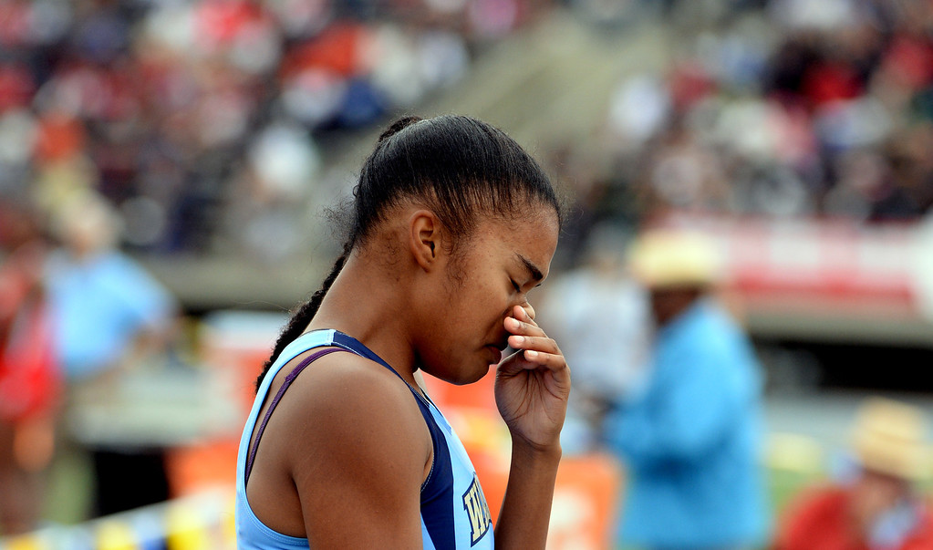 Description of . Walnut's Kayla Richardson after the division 1 100 meter dash during the CIF Southern Section track and final Championships at Cerritos College in Norwalk, Calif., Saturday, May 24, 2014. 