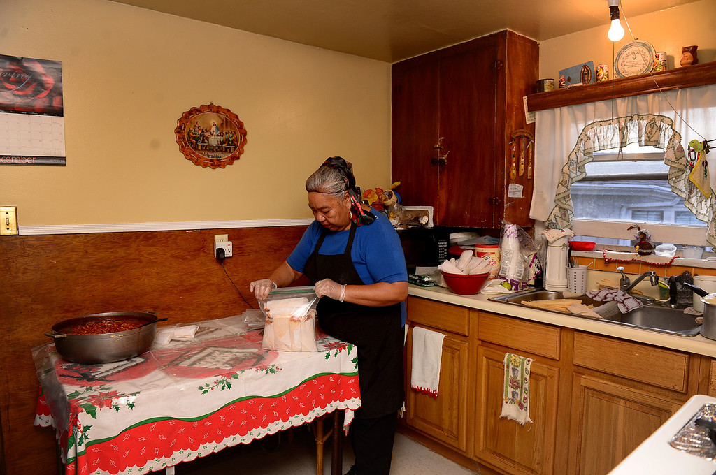 Description of . Santos Garza, 68, makes Christmas tamales for friends and family Saturday, December 21, 2013 in her Rosemead home that she shares with her 83-year-old husband Emede. Garza expects to make 18 dozen chicken, cheese and pork tamales this year. Tamales are a Christmas Eve tradition in Mexico. (Photo by Sarah Reingewirtz/Pasadena Star-News)