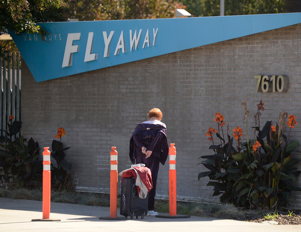 Description of . The popular Flyaway bus system to LAX was shutdown at 9:30am after the shooting at LAX that killed one TSA agent. Travelers who were on the busses on the way to LAX were stuck and turn back to Van Nuys airport. Other travelers arriving at the Flyaway during the shutdown were turn away being that no buses were running till further notice. Nov 1 ,2013. photo by Gene Blevins/LA Daily News