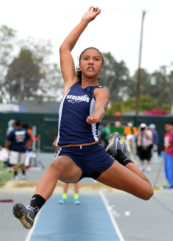 Description of . Redland's Margaux Jones competes in the Division 2 long jump during the CIF Southern Section track and final Championships at Cerritos College in Norwalk, Calif., Saturday, May 24, 2014. 