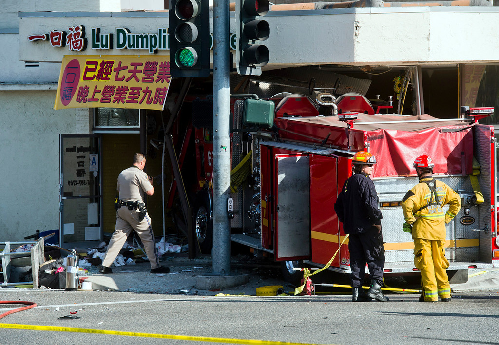 Description of . Emergency personnel investigate the scene after a fire truck crashed into Lu Dumpling House restaurant in Monterey Park on Wednesday, April 16, 2014. (Photo by Watchara Phomicinda/ San Gabriel Valley Tribune)
