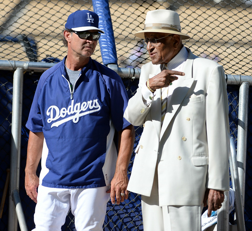 Description of . Former Brooklyn Dodger pitcher Don Newcombe, right, with Los Angeles Dodgers manager Don Mattingly prior to a Major league baseball game between the San Diego Padres and the Los Angeles Dodgers on Saturday, July 12, 2014 in Los Angeles.   (Keith Birmingham/Pasadena Star-News)
