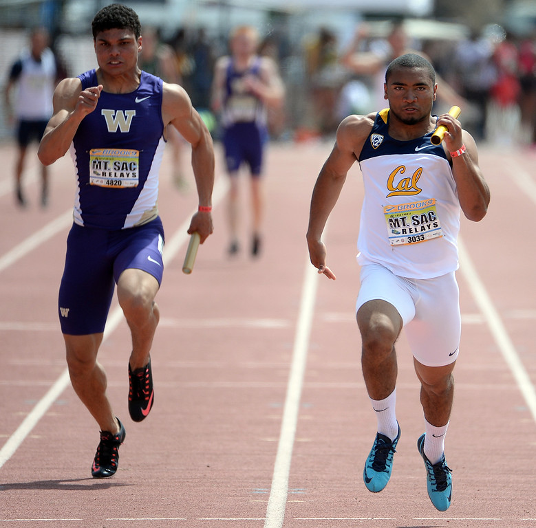 Description of . Cal's Khalfani Muhammad, right, competes in the 4x100 meter relay Invitational Elite during the Mt. SAC Relays in Hilmer Lodge Stadium on the campus of Mt. San Antonio College in Walnut, Calif., on Saturday, April 19, 2014. 