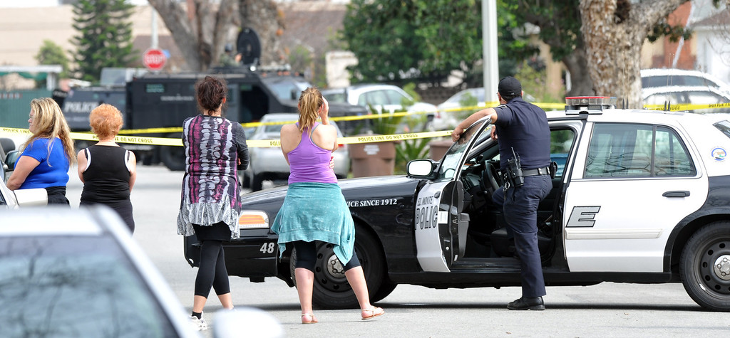 Description of . Neighbor watch El Monte SWAT Team members at the home on the 11400-block of Elmcrest Street in El Monte finding the suspect dead after a standoff on Friday March 7, 2014. The suspect shot his neighbor over a dispute Friday morning. (Photo by Keith Durflinger/San Gabriel Valley Tribune)