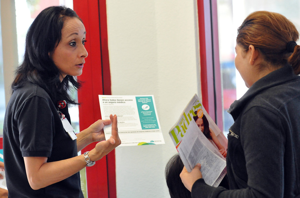 Description of . (John Valenzuela/Staff Photographer)  Joann Schmidt, community outreach coordinator for Molina Medical provides information to a member about health insurance with Covered California at Molina Medical in Fontana, Tuesday, Oct. 1, 2013. Today kick off the first day of open enrollment for Covered CA, the marketplace for affordable, private health insurance, Molina Medical  hosted an informational event for its patients and the Inland Empire community.