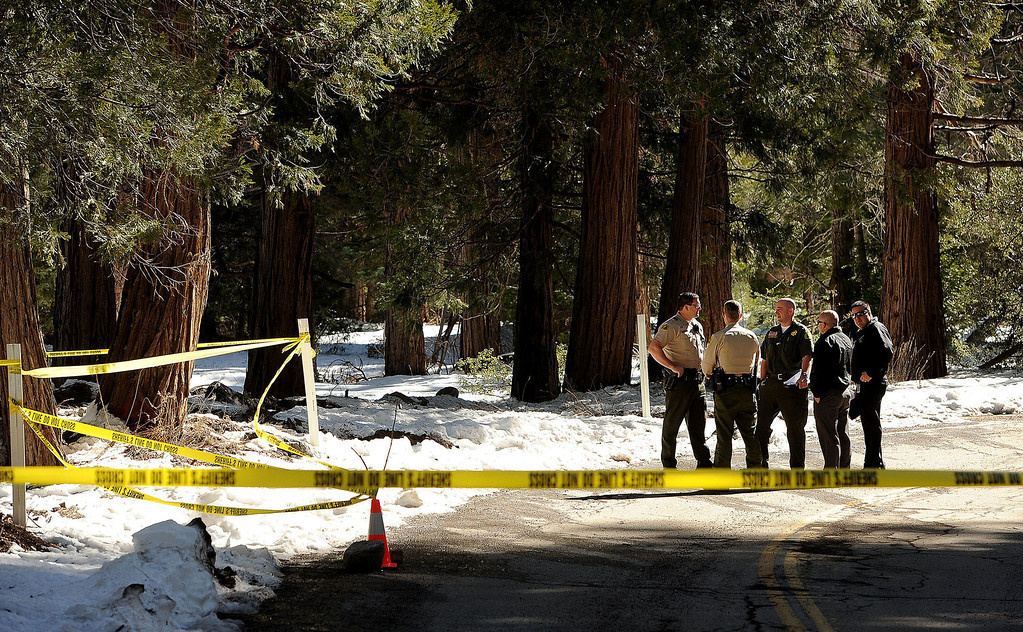 Description of . San Bernardino County Sheriff's Deputies collected what is believed to be handgun and silencer belonging to fugitive Christopher Dorner from an area along Glass Road as seen in Seven Oaks February 15, 2013. (Staff photo by Gabriel Luis Acosta/The Sun)
