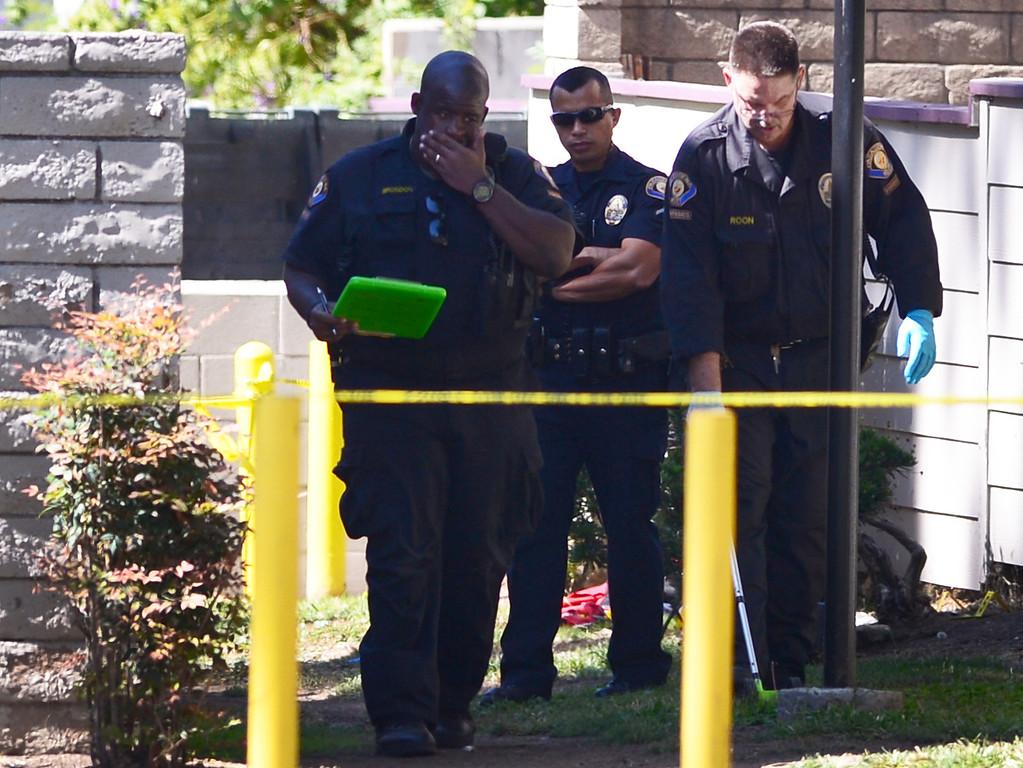Description of . Pasadena Police investigate an officer involved shooting at Kings Village in Pasadena Friday, October 11, 2013. (Photo by Sarah Reingewirtz/Pasadena-Star News)