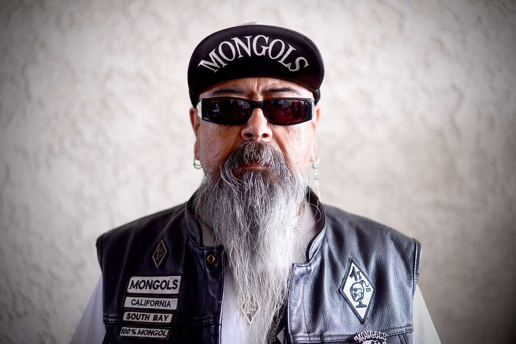 Description of . Mexican Don, of the Mongols South Bay Chapter, poses as motorcycle club members rally Saturday, March 29, 2013 at The House Lounge in Maywood in support of the Mongols who are facing a federal trial seeking to take away their trademark patch. (Photo by Sarah Reingewirtz/Pasadena Star-News)