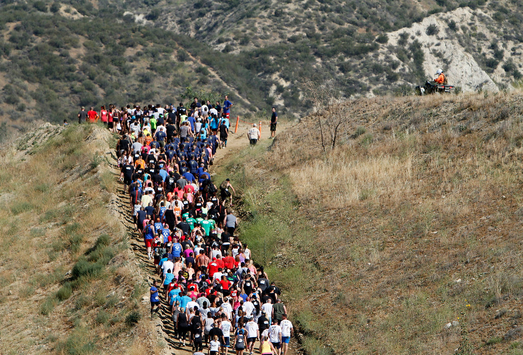 Description of . Runners make their way up a hill during the Sheriff's Athletic Federation's annual 5K Mud Run on Saturday, May 17, 2014 at the Sheriff's Department Academy in Devore, Ca. (Photo by Micah Escamilla/San Bernardino Sun)