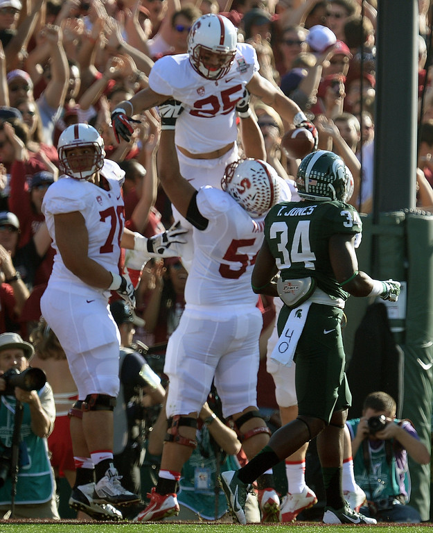 Description of . Stanford's Tyler Gaffney #25 celebrates scoring a touchdown against Michigan State during the 100th Rose Bowl game in Pasadena Wednesday, January 1, 2014. (Photo by Hans Gutknecht/Los Angeles Daily News)