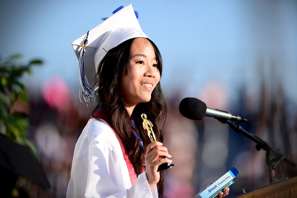 Description of . Yun-Ju Chen gives the valedictory address during Duarte High School's commencement ceremony Thursday night,  June 12, 2014 at the Duarte school. (Photo by Sarah Reingewirtz/Pasadena Star-News)